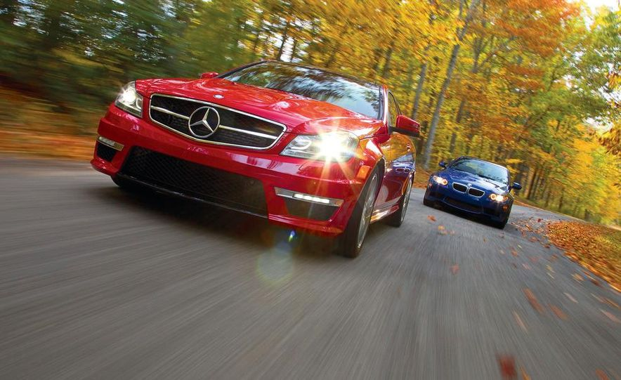 2012 Mercedes-Benz C63 AMG coupe and 2012 BMW M3 coupe - Slide 1