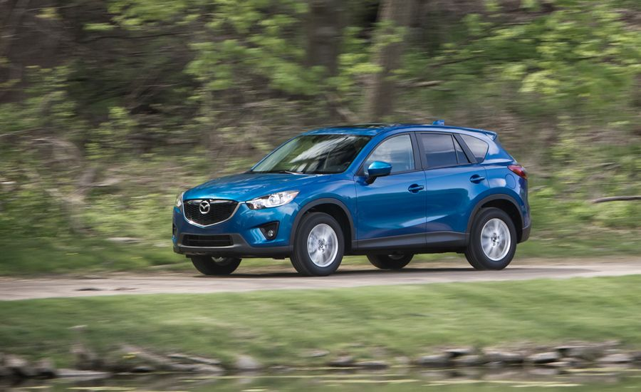 https://hips.hearstapps.com/amv-prod-cad-assets.s3.amazonaws.com/images/12q2/450434/2013-mazda-cx-5-touring-awd-test-review-car-and-driver-photo-457496-s-original.jpg?crop=1xw:1xh;center,center&resize=900:*
