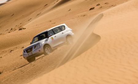 Nail It, Muneer, and Don't Spare the Horses: The Impossible Weirdness of the Dubai Desert Dune Tour