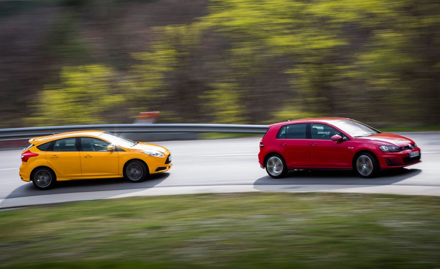 2015 volkswagen gti vs 2013 ford focus st comparison test car and driver. Black Bedroom Furniture Sets. Home Design Ideas