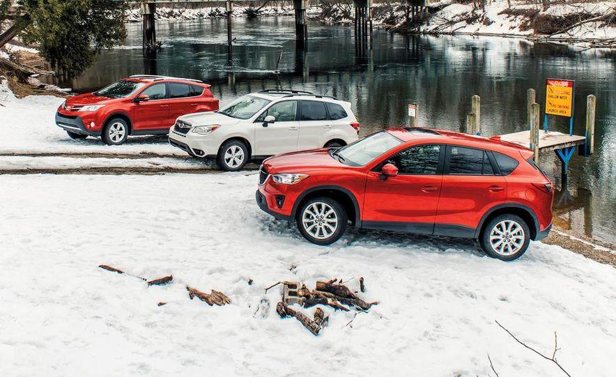2013 Toyota RAV4 XLE AWD, 2014 Subaru Forester 2.5i Touring, and 2014 Mazda CX-5 Grand Touring AWD - Slide 1