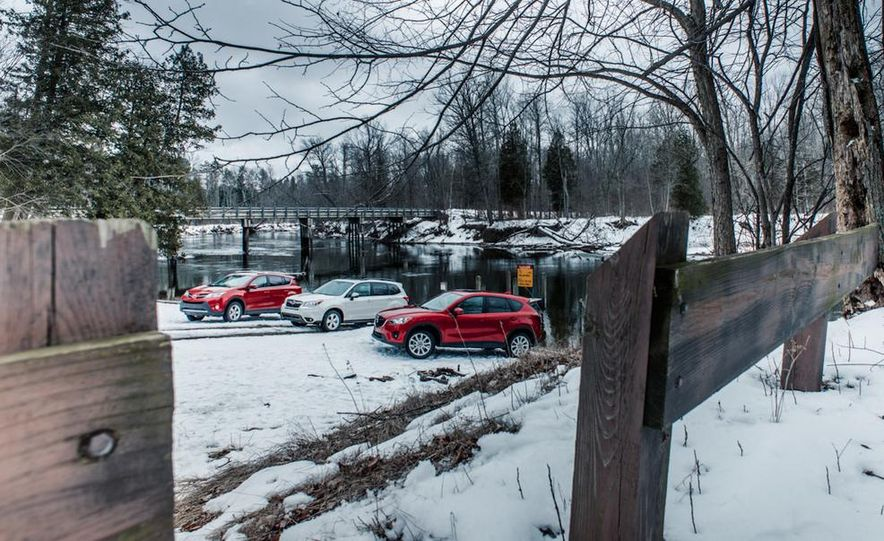 2013 Toyota RAV4 XLE AWD, 2014 Subaru Forester 2.5i Touring, and 2014 Mazda CX-5 Grand Touring AWD - Slide 2