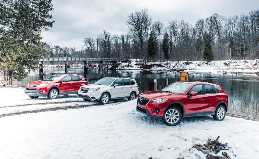 2013 Toyota RAV4 XLE AWD, 2014 Subaru Forester 2.5i Touring, and 2014 Mazda CX-5 Grand Touring AWD - Slide 3