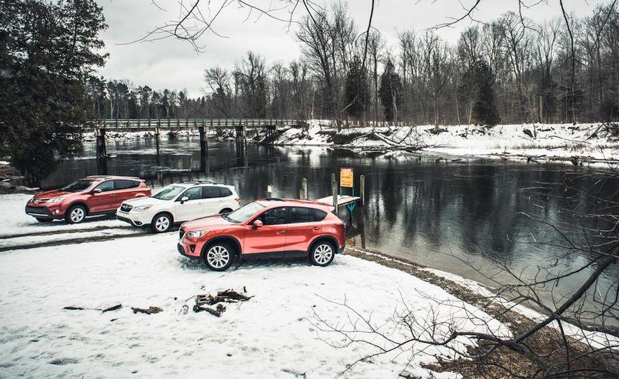 2013 Toyota RAV4 XLE AWD, 2014 Subaru Forester 2.5i Touring, and 2014 Mazda CX-5 Grand Touring AWD - Slide 5