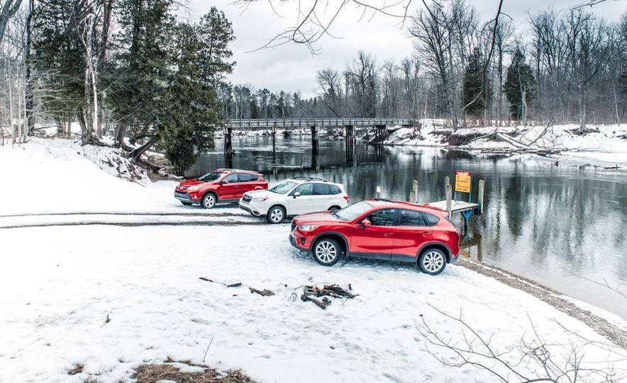 2013 Toyota RAV4 XLE AWD, 2014 Subaru Forester 2.5i Touring, and 2014 Mazda CX-5 Grand Touring AWD - Slide 6