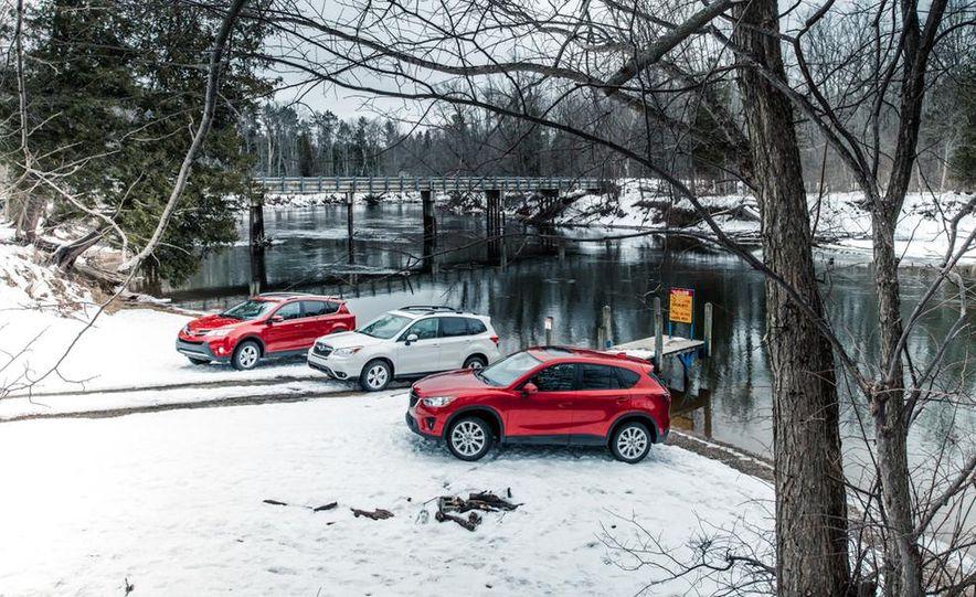 2013 Toyota RAV4 XLE AWD, 2014 Subaru Forester 2.5i Touring, and 2014 Mazda CX-5 Grand Touring AWD - Slide 7