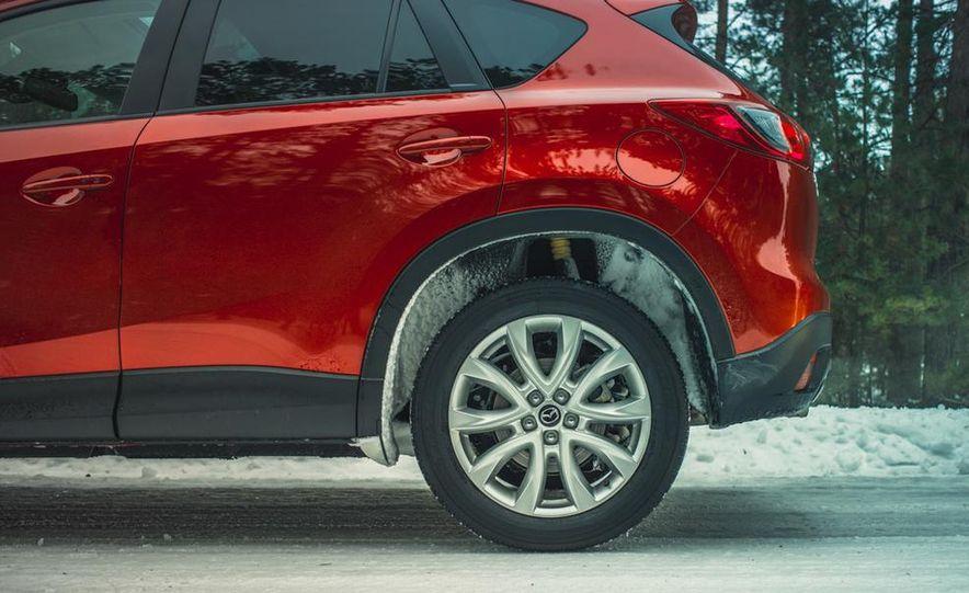 2013 Toyota RAV4 XLE AWD, 2014 Subaru Forester 2.5i Touring, and 2014 Mazda CX-5 Grand Touring AWD - Slide 65