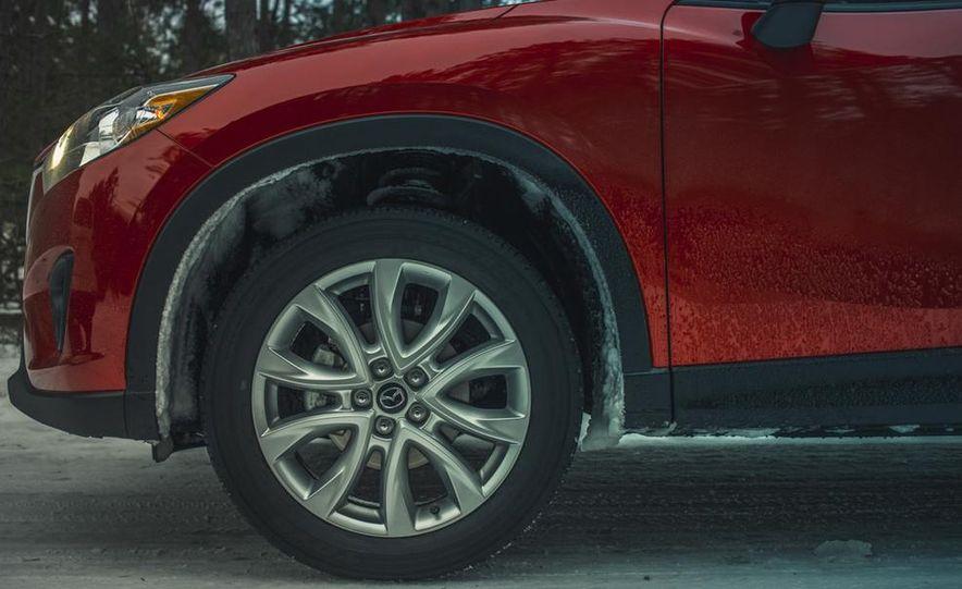 2013 Toyota RAV4 XLE AWD, 2014 Subaru Forester 2.5i Touring, and 2014 Mazda CX-5 Grand Touring AWD - Slide 64