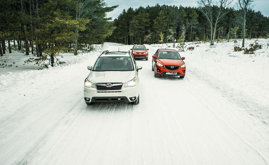 2013 Toyota RAV4 XLE AWD, 2014 Subaru Forester 2.5i Touring, and 2014 Mazda CX-5 Grand Touring AWD - Slide 9