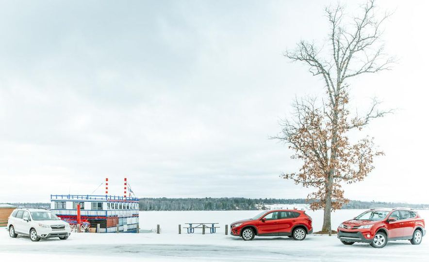 2013 Toyota RAV4 XLE AWD, 2014 Subaru Forester 2.5i Touring, and 2014 Mazda CX-5 Grand Touring AWD - Slide 10