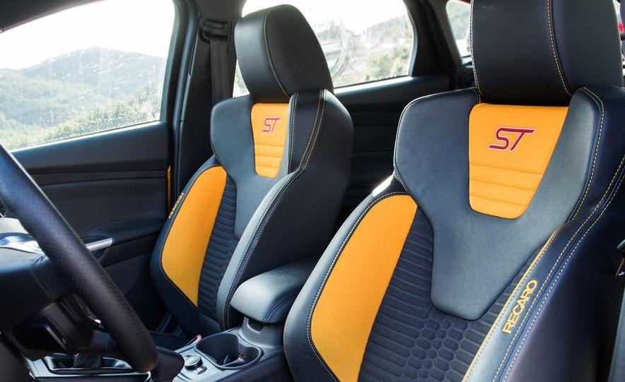 2015 Volkswagen GTI 5-door and 2013 Ford Focus ST (Euro-spec) - Slide 42