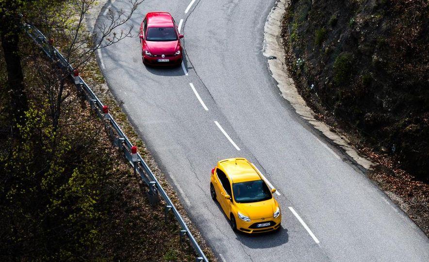 2015 Volkswagen GTI 5-door and 2013 Ford Focus ST (Euro-spec) - Slide 13
