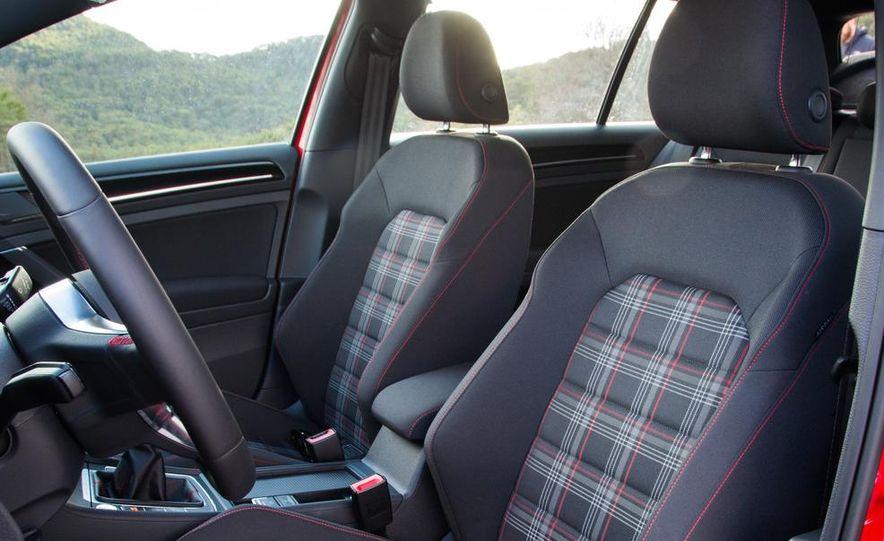 2015 Volkswagen GTI 5-door and 2013 Ford Focus ST (Euro-spec) - Slide 27