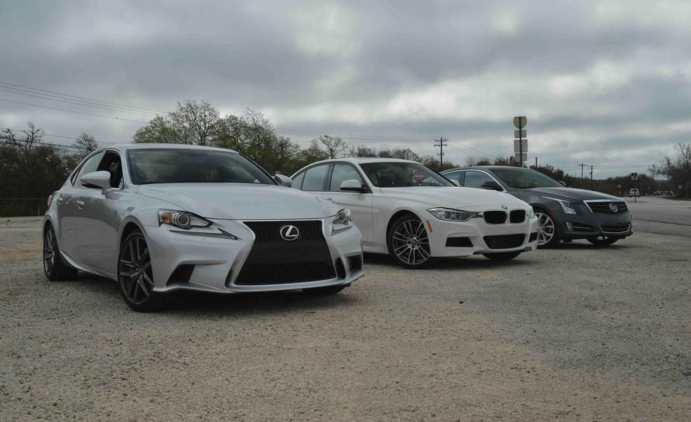 2014 Lexus IS350 F Sport 2013 BMW 335i M Sport and 2013 Cadillac