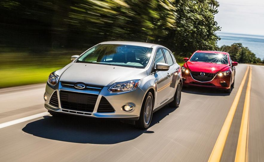 2014 Ford Focus SE and 2014 Mazda 3 i Grand Touring - Slide 1