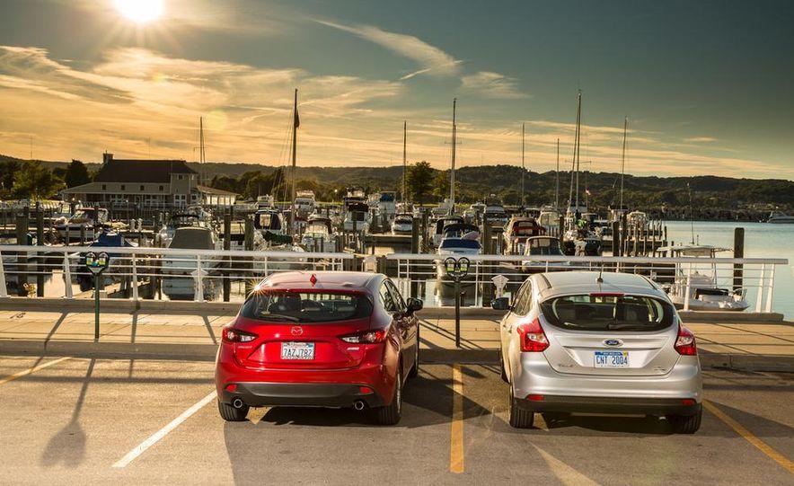 2014 Ford Focus SE and 2014 Mazda 3 i Grand Touring - Slide 4