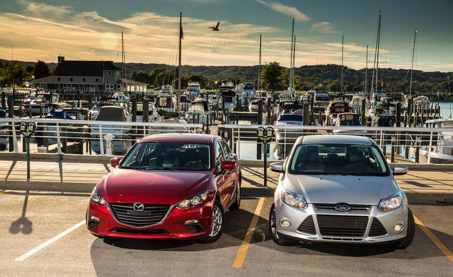 2014 Ford Focus SE and 2014 Mazda 3 i Grand Touring - Slide 5