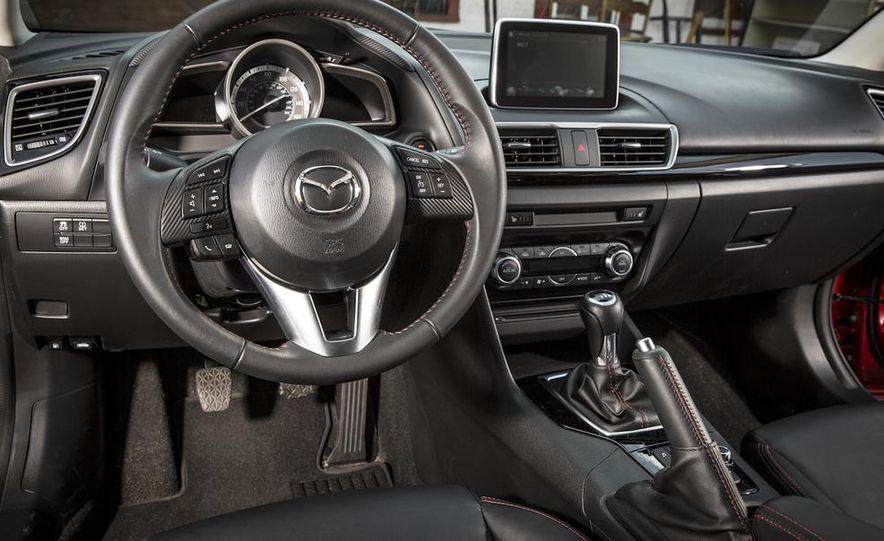 2014 Ford Focus SE and 2014 Mazda 3 i Grand Touring - Slide 30