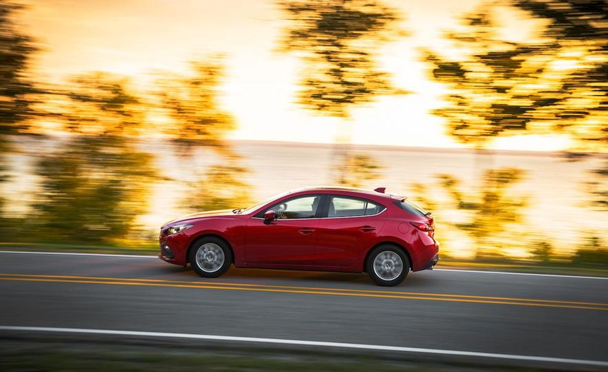 2014 Ford Focus SE and 2014 Mazda 3 i Grand Touring - Slide 22