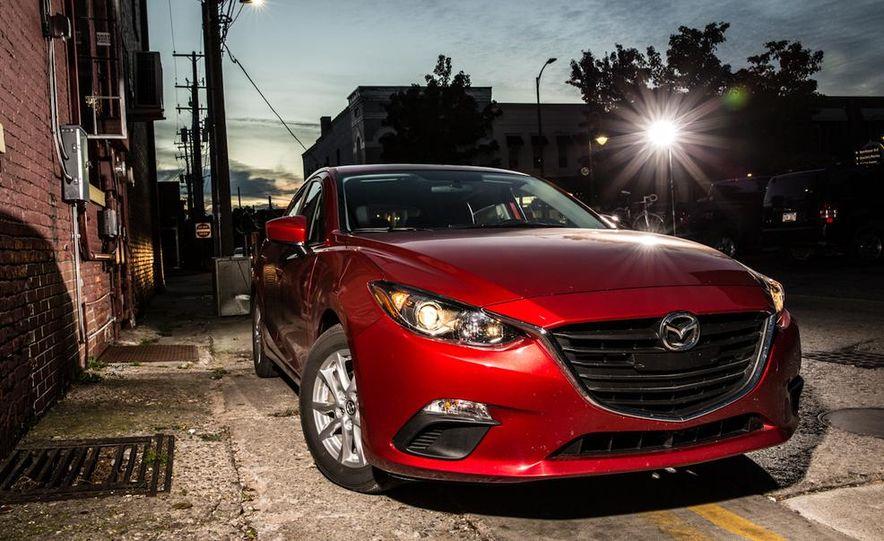 2014 Ford Focus SE and 2014 Mazda 3 i Grand Touring - Slide 25