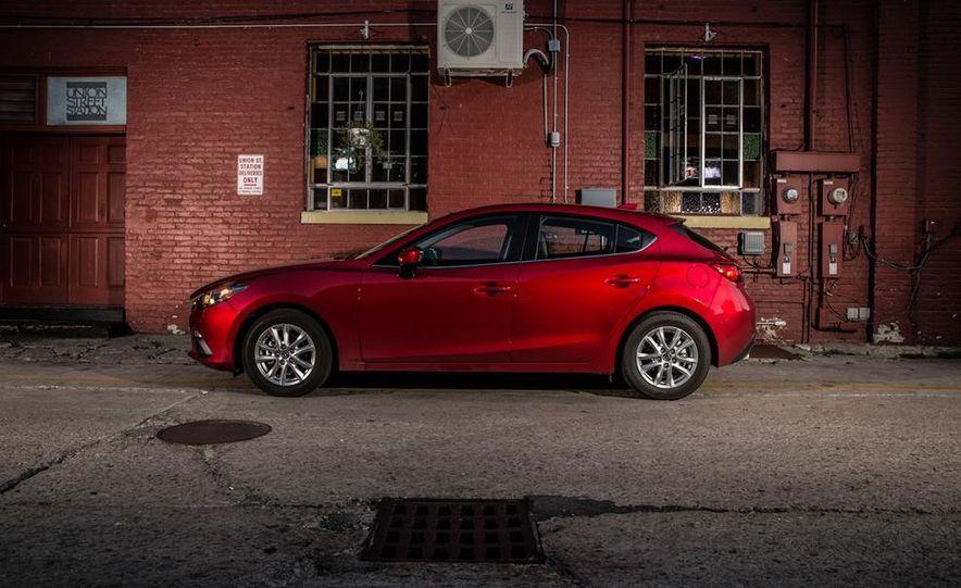 2014 Ford Focus SE and 2014 Mazda 3 i Grand Touring - Slide 26