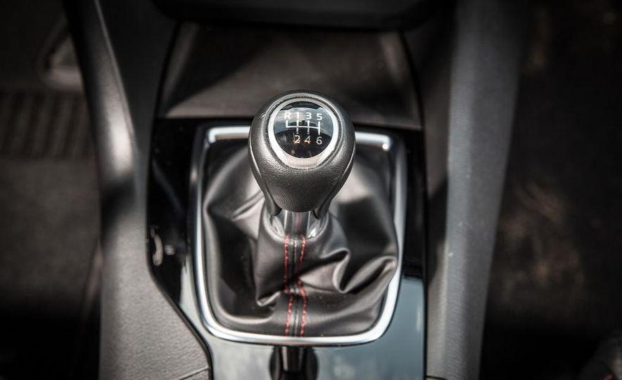 2014 Ford Focus SE and 2014 Mazda 3 i Grand Touring - Slide 32