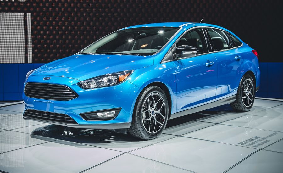 2015 ford focus sedan photos and info news car and driver. Black Bedroom Furniture Sets. Home Design Ideas