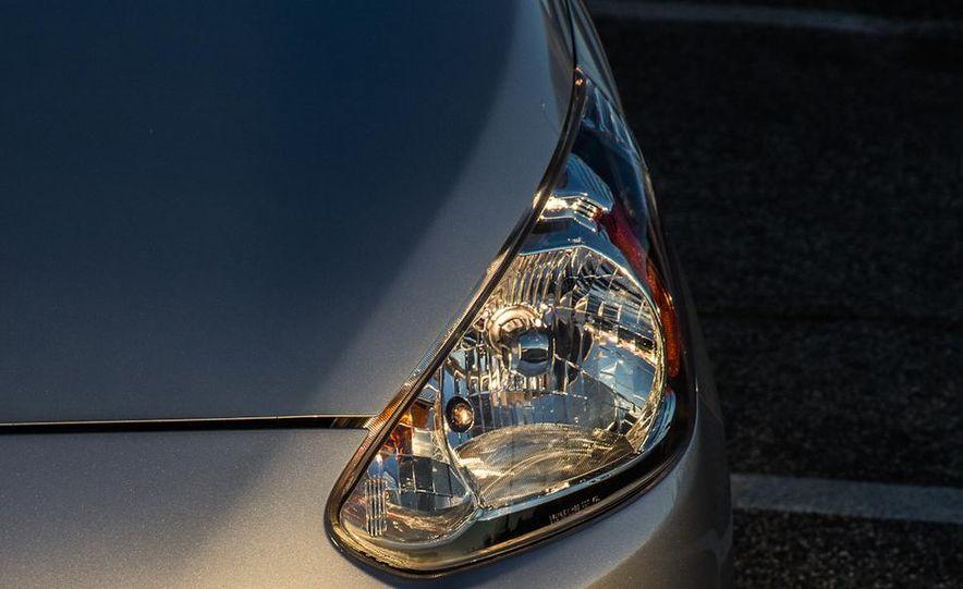 2005 Volkswagen Phaeton and 2014 Mitsubishi Mirage ES - Slide 10