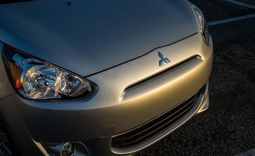 2005 Volkswagen Phaeton and 2014 Mitsubishi Mirage ES - Slide 9