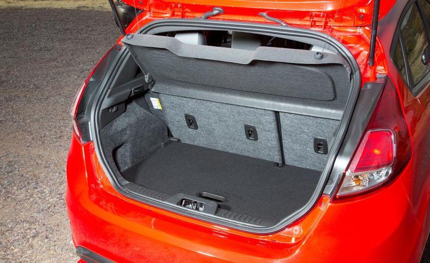 2014 Ford Fiesta ST, 2014 Mini Cooper S Hardtop, and 2014 Fiat 500 Abarth - Slide 68