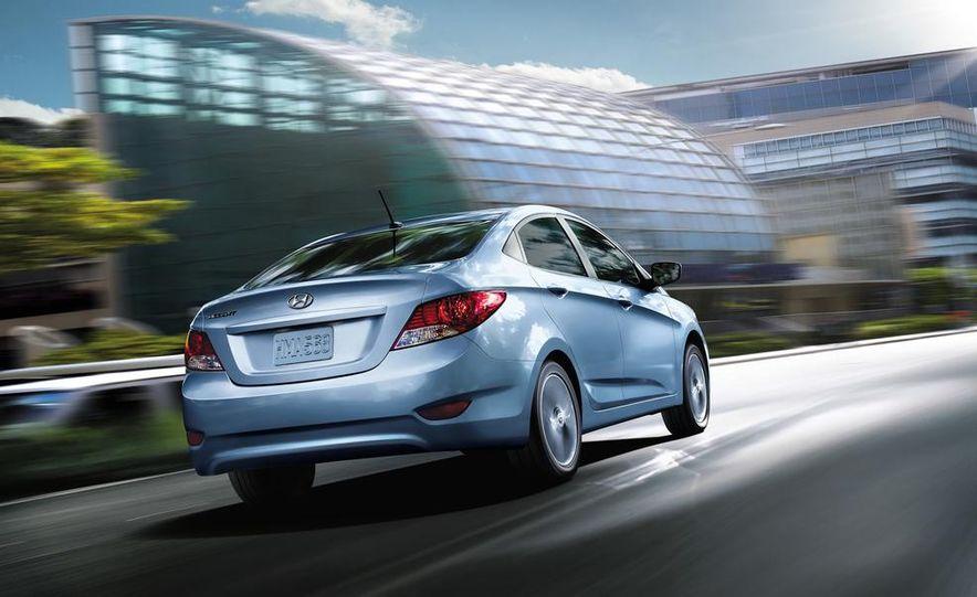 2014 Hyundai Accent hatchback and 2014 Hyundai Accent sedan models shown - Slide 2