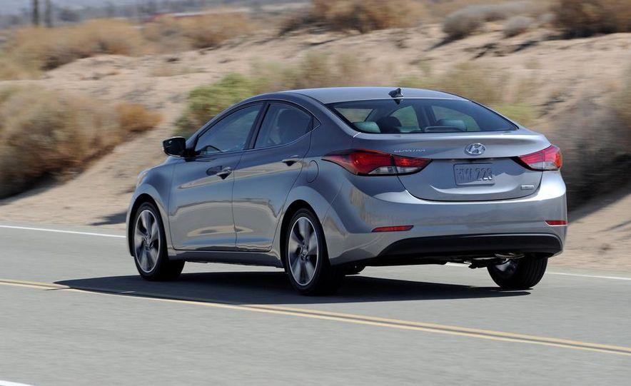 2014 Hyundai Accent hatchback and 2014 Hyundai Accent sedan models shown - Slide 12