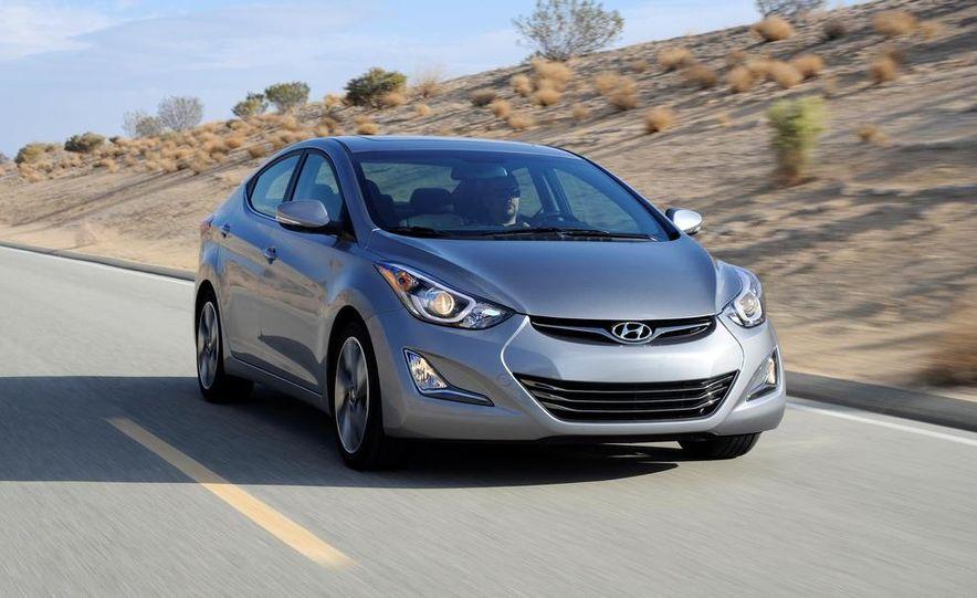 2014 Hyundai Accent hatchback and 2014 Hyundai Accent sedan models shown - Slide 13