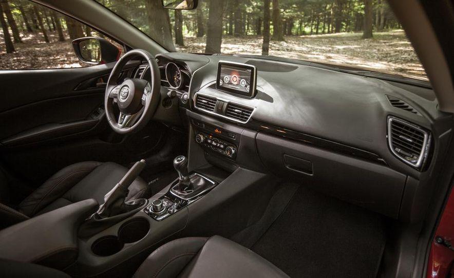 2013 Mazda 2 model shown - Slide 12