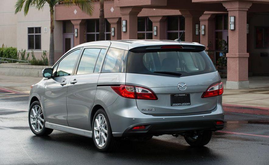 2013 Mazda 2 model shown - Slide 14