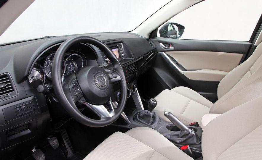 2013 Mazda 2 model shown - Slide 26
