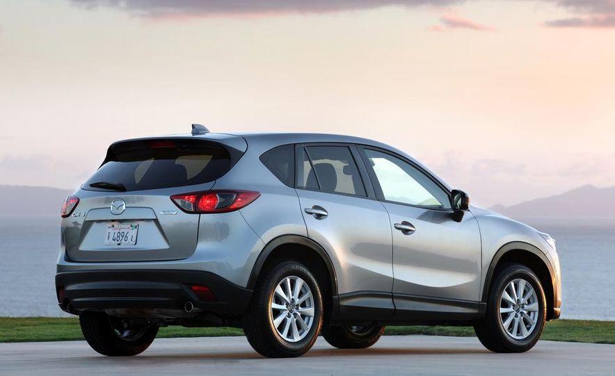 2013 Mazda 2 model shown - Slide 25