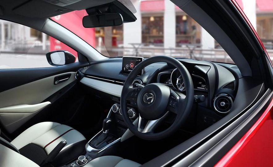 2013 Mazda 2 model shown - Slide 9