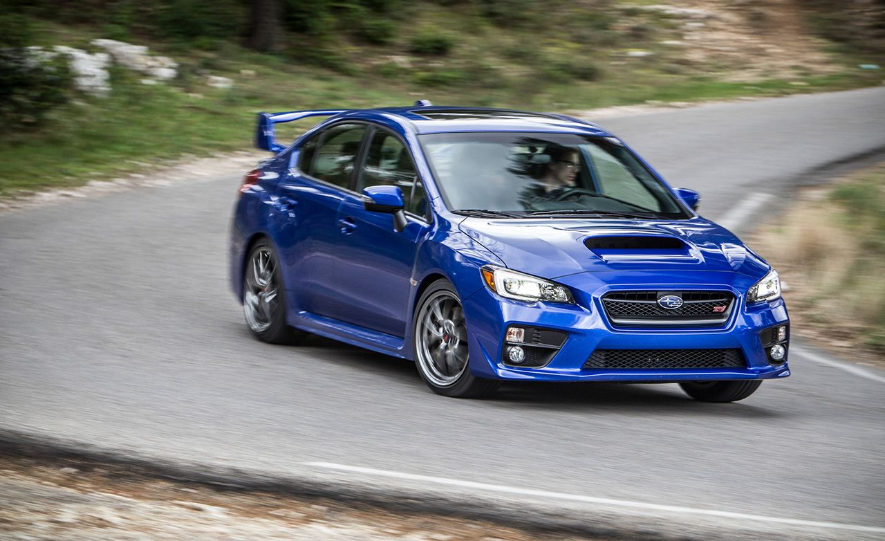 2018 Subaru Wrx Sti Type Ra First Drive Review Car And Driver Blue With White Rims
