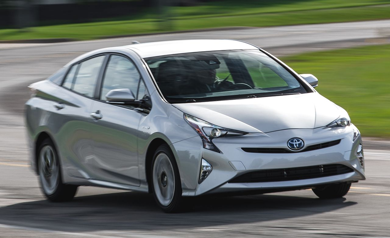 Toyota Prius Reviews Price Photos And Specs Car Driver