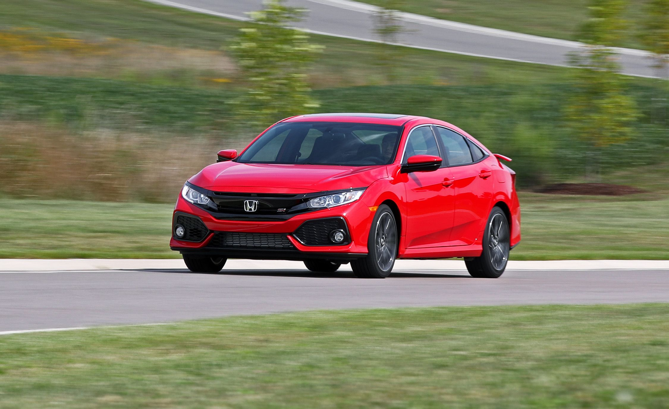 honda civic si reviews honda civic si price photos and specs car and driver. Black Bedroom Furniture Sets. Home Design Ideas