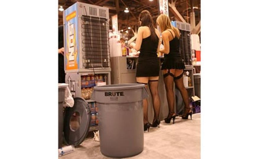 We're sure they're wholesome gals when not in lingerie, standing next to a trash can. - Slide 1