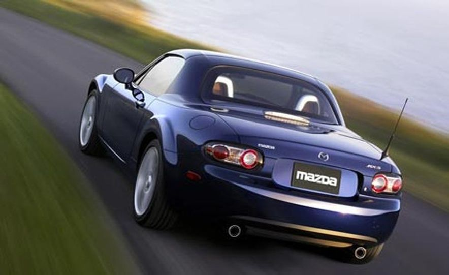 Our head instructor gives us a walk-around of the various modifications to the MX-5 Cup cars. - Slide 9