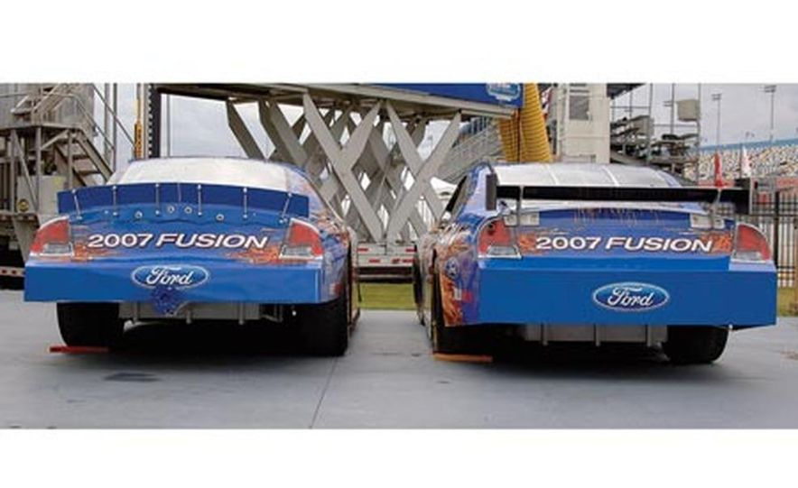 The Ford version of NASCAR's car of tomorrow (left) sits side by side with the soon-to-be-extinct Ford of today. The major differences visible here are the rear wing, which replaces the spoiler, and the front splitter, which replaces the air dam. - Slide 2