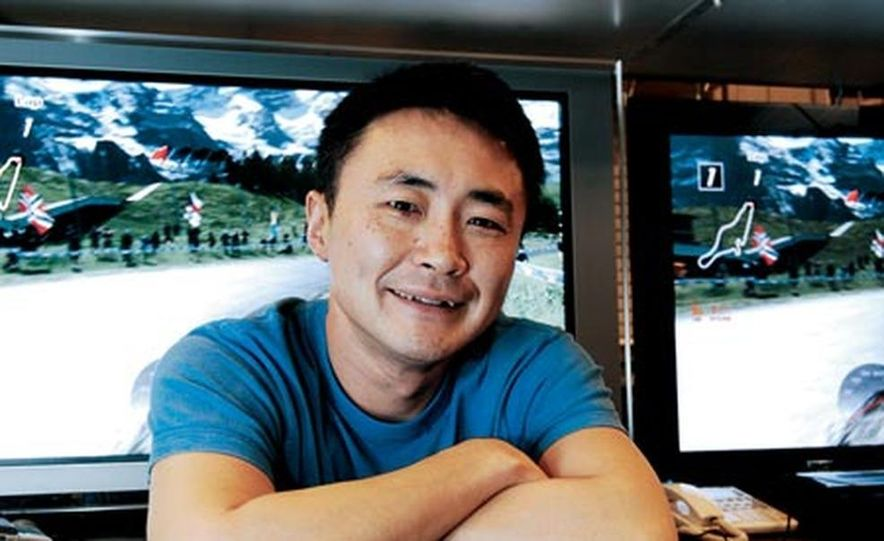 Gran Turismo creator Kazunori Yamauchi, 39, wondered as a teenager why video driving games didn't feature real cars. He's a family man with two kids and a dream garage: two Ford GTs, a Porsche 911 GT3, a Mercedes-Benz SL55 AMG, and a Nissan 350Z and a Honda S2000, both tuner massaged. His next goal: to direct a movie about cars. - Slide 1