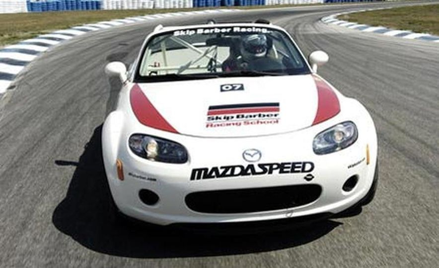 Our head instructor gives us a walk-around of the various modifications to the MX-5 Cup cars. - Slide 4