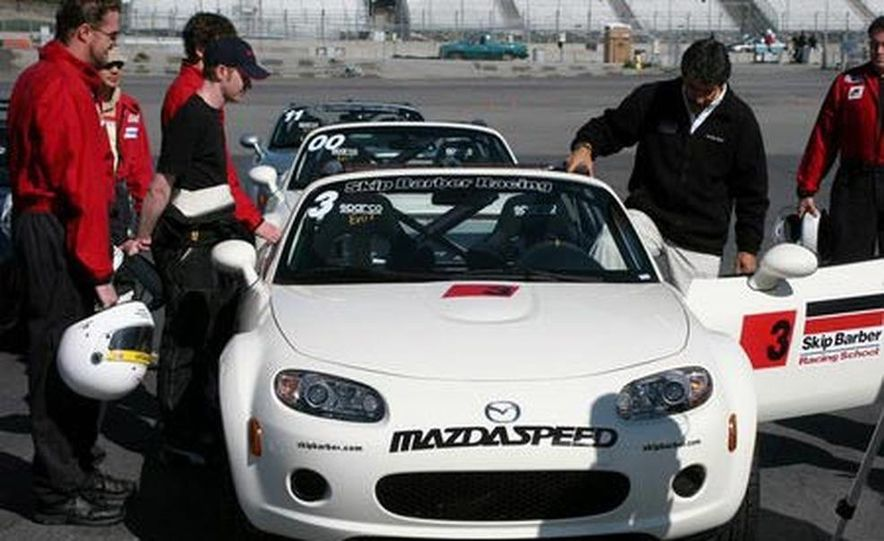 Our head instructor gives us a walk-around of the various modifications to the MX-5 Cup cars. - Slide 1
