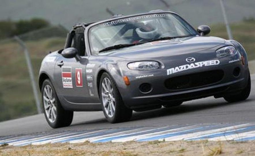 Our head instructor gives us a walk-around of the various modifications to the MX-5 Cup cars. - Slide 3