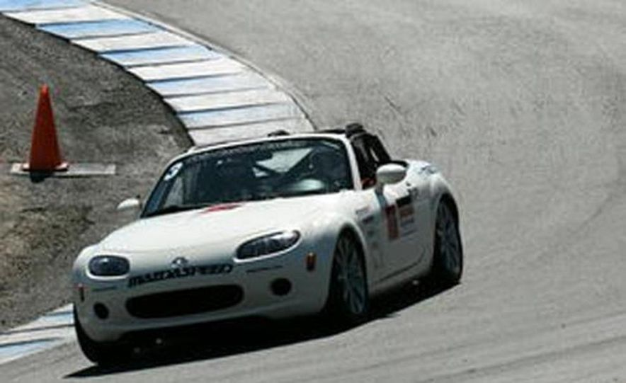 Our head instructor gives us a walk-around of the various modifications to the MX-5 Cup cars. - Slide 5