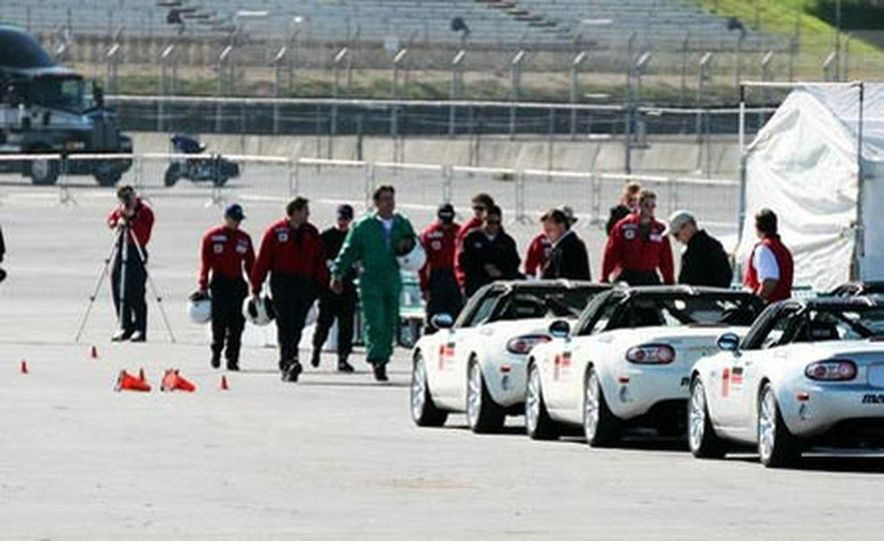 Our head instructor gives us a walk-around of the various modifications to the MX-5 Cup cars. - Slide 6